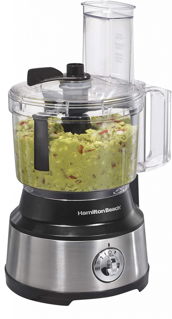 Hamilton Beach brand food processor with stainless steel motor blades filled with guacamole