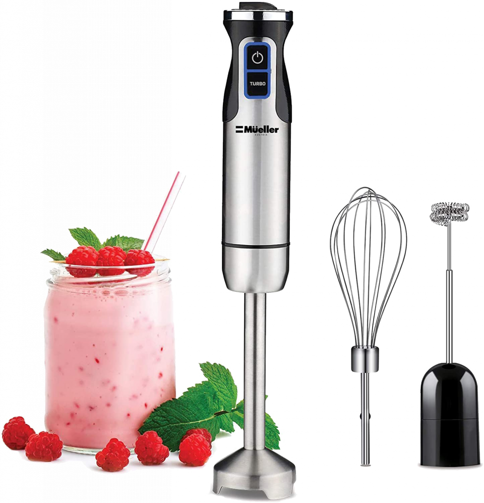 Mueller brand immersion blender with steel handle next to detachable whisks and a glass of raspberry smoothie