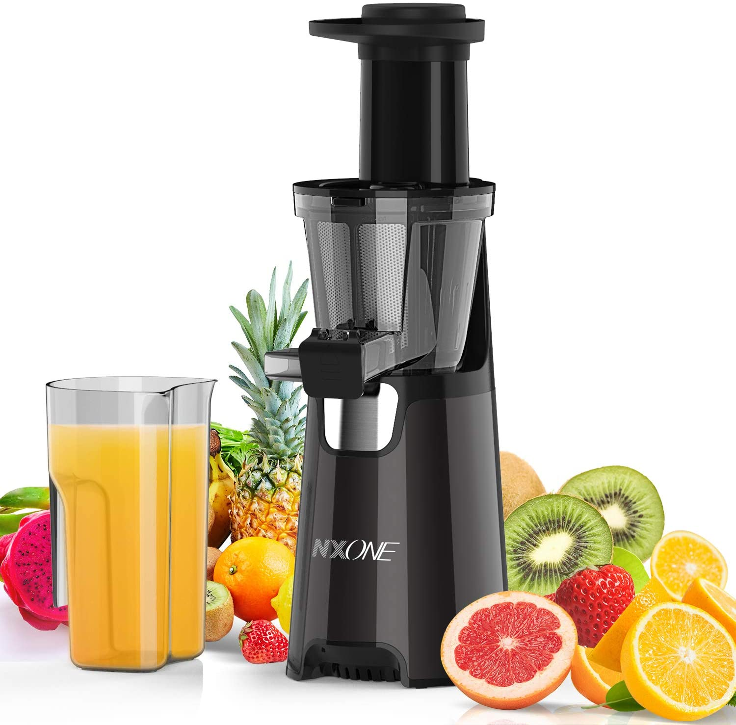 A black slow juicer next to a pitcher of orange juice and fresh fruits